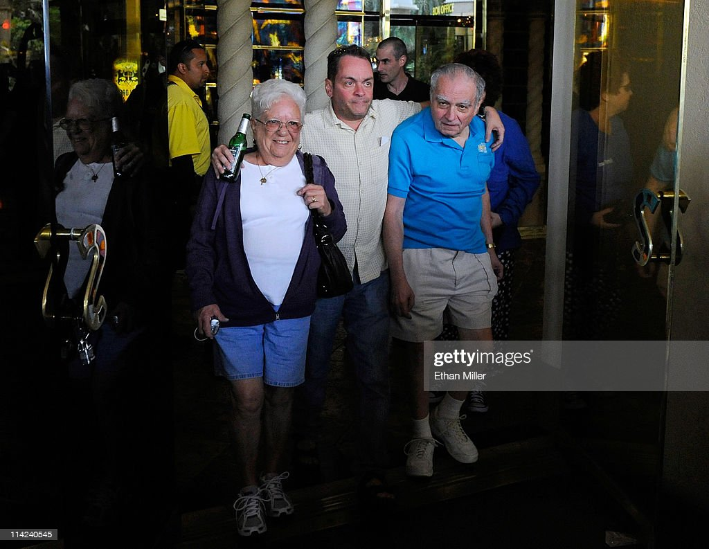 Barbara Zappulla, her son Joseph Zappulla and his father Larry Zappulla are some of the last people to walk out the front doors of the Sahara Hotel & Casino shortly before the property was closed on May 16, 2011 in Las Vegas, Nevada. Joseph Zappulla said his parents have visited the Sahara many times since 1961. The Sahara's current owner SBE Entertainment Group closed the 1,720-room resort, which first opened in 1952, and plans to redevelop the site in the future.