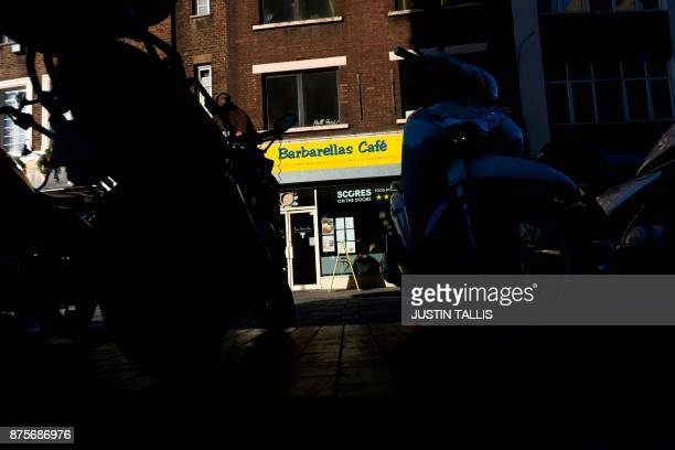 Barbarellas cafe is pictured beyond a row of parked motorcycles in London on November 17 2017 / AFP PHOTO / Justin TALLIS