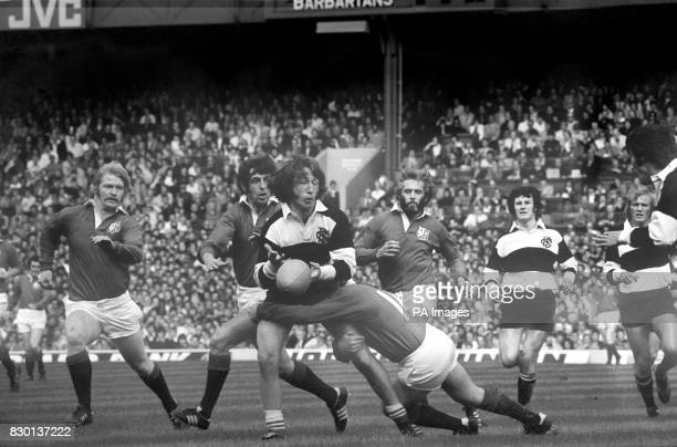 Barbarians' full back JPR Williams tacked by British Lions right wing Peter Squires in the Silver Jubilee rugby match at Twickingham The Lions won by...