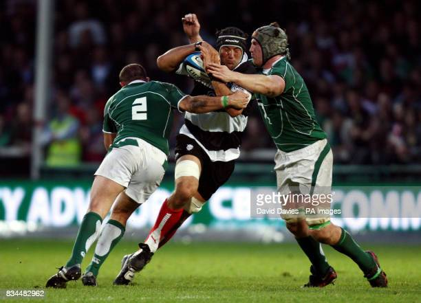 Barbarians' Santiago Dellape is tackled by Bob Casey and Rory Best of Ireland during the International match at Kingsholm Gloucester
