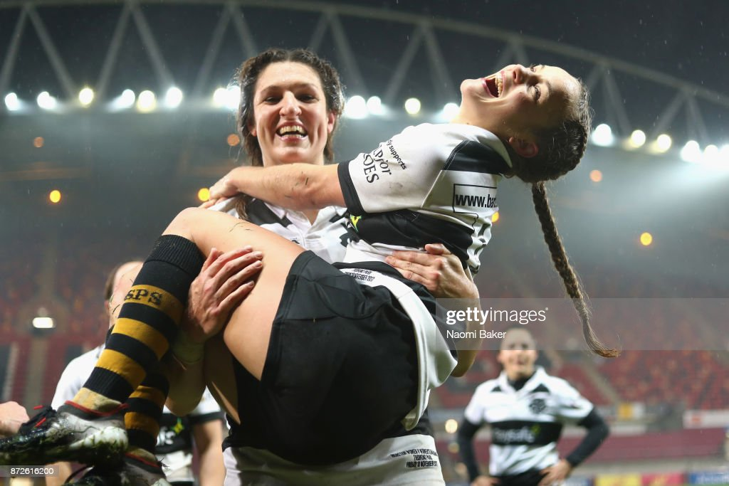 Barbarians teammates Lenaig Corson carries Tova Derk during the team celebrations after the Inaugural Representative Match between Barbarians Women's RFC and Munster Women, on November 10, 2017 in Limerick, Ireland.