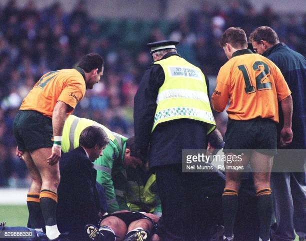 Barbarian's Tim Stimpson's lies injured as he is tended to by ambulance men during their match against Australia at Twickenham today Photo by Neil...