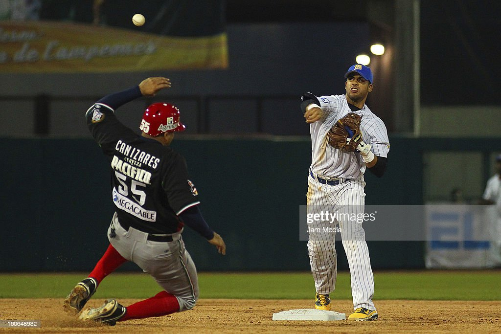 Barbaro Canizares of Mexico and Reegie Corona of Venezuela in action during the Caribbean Series Baseball 2013 in Sonora Stadium on February 2, 2013 in Hermosillo, Mexico.