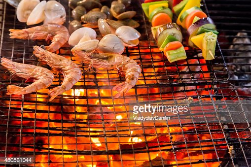 Barbecue Grill cooking shrimp seafood. : Stock Photo