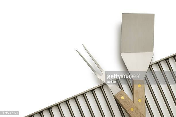 Barbecue grill, serving fork and spatula on white background