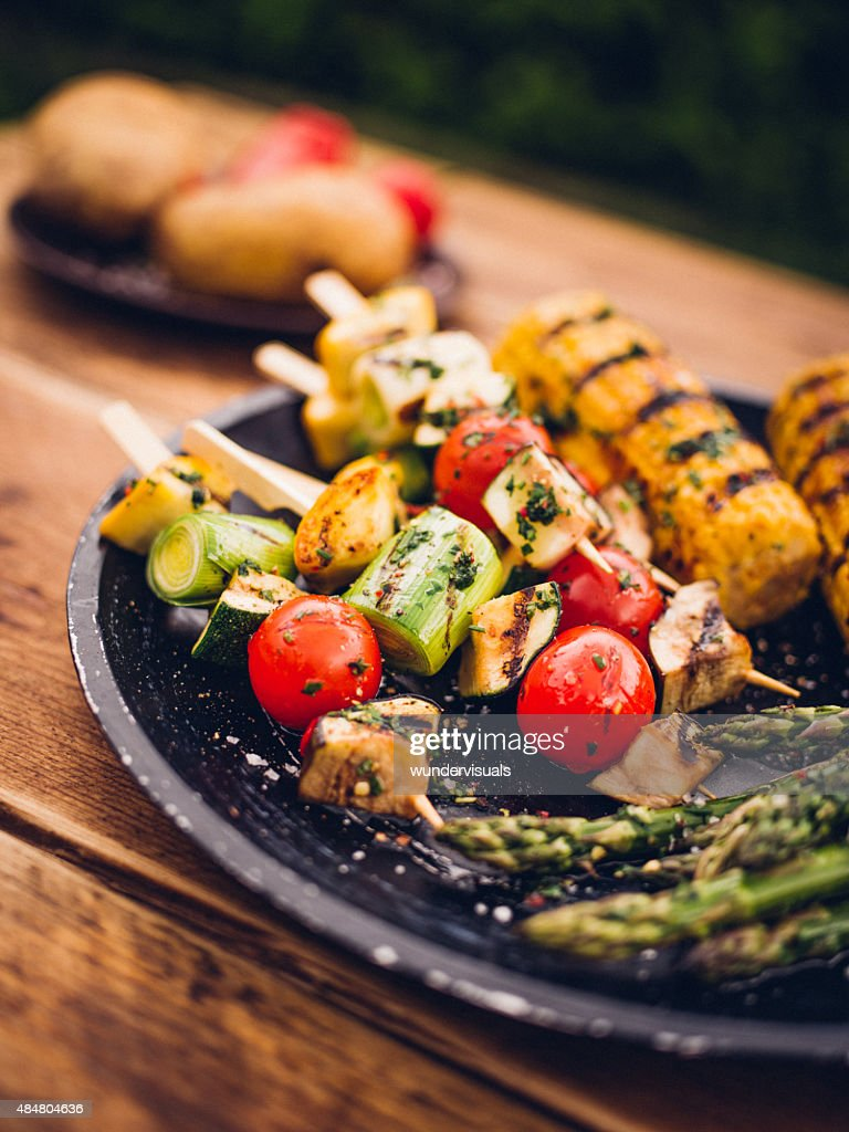 Barbecue grilled vegetable kebabs, corn and asparagus on a plate : Stock Photo