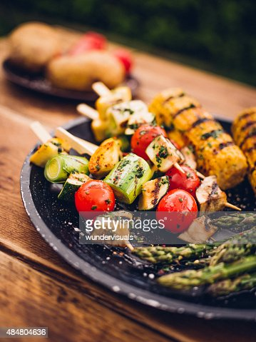 Barbecue grilled vegetable kebabs, corn and asparagus on a plate