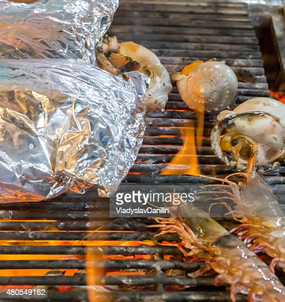 Barbecue seafood on the flaming grill. : Stock Photo