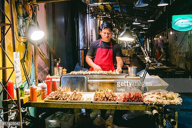 Barbecue shop in the night market in Bangkok