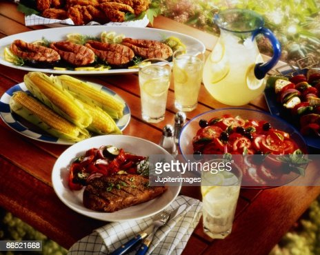 Barbecue spread on picnic table