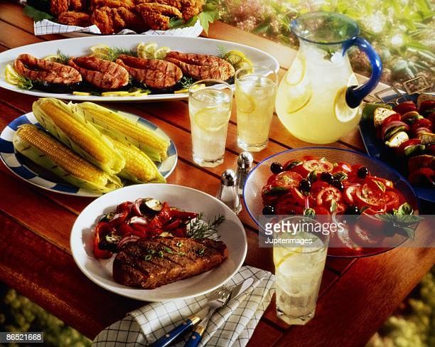 Barbecue spread on picnic table