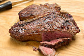 A high angle extreme close up shot of a barbecued Porterhouse steak