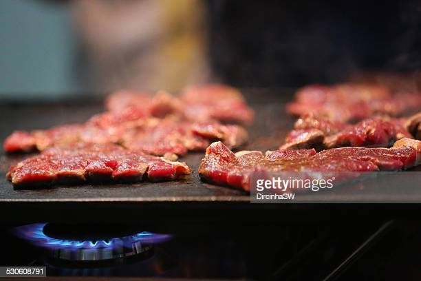 Barbecuing beef on the grill.