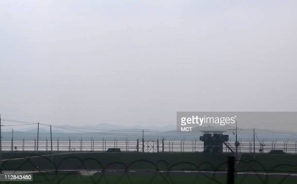 Barbed wire and guard posts are seen along the highway leading north from Seoul to the DMZ June 16 2010