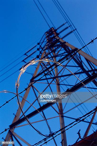 Barbed wire around electrical tower