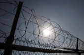 A barbed wire fence at a military check point near the demilitarized zone separates South and North Korea on April 9 2013 in Paju South Korea North...