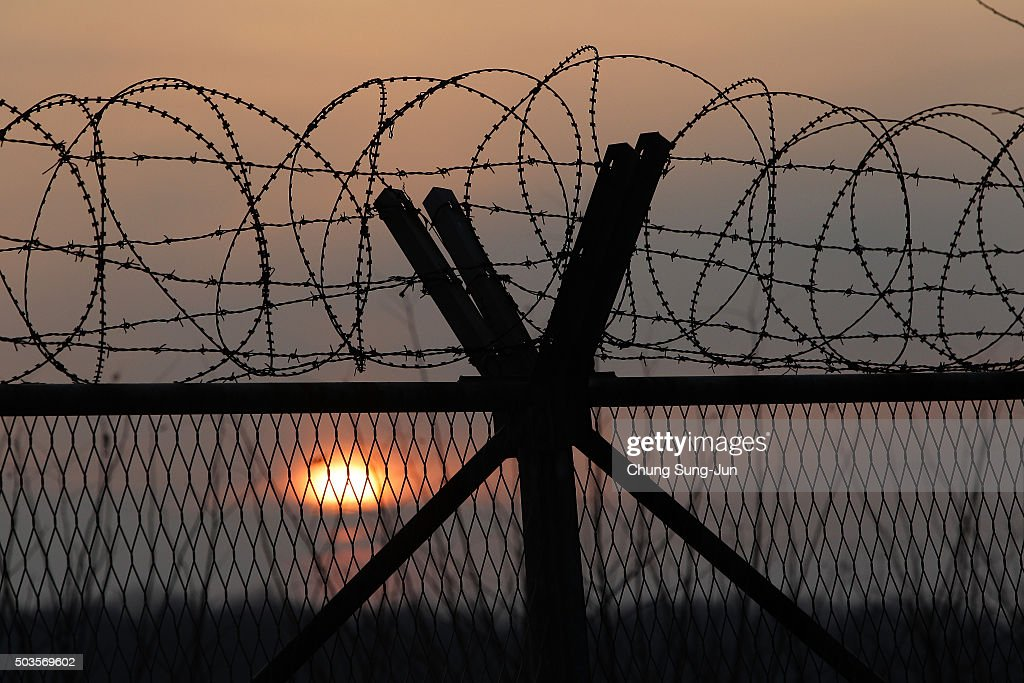 A barbed wire fence at a military check point near the demilitarized zone separates South and North Korea on January 6 2016 in Paju South Korea North...