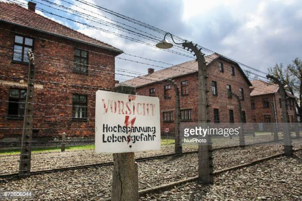 A barbed wire fence at the former NaziGerman Auschwitz concentration and extermination camp at Oswiecim Poland on April 24 2017