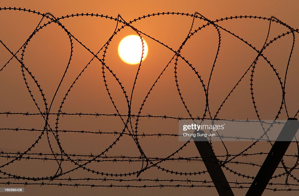 A barbed wire fence at the military check point, near the Demilitarized zone (DMZ) separates South and North Korea on April 4, 2013 in Paju, South Korea. 400 South Koreans remain in the joint industrial complex fearing they can not get back there once return to South. In recent weeks North Korea have threatened to attack South Korea and U.S. military bases.