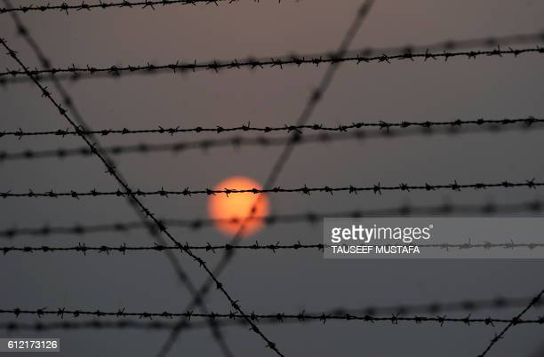 A barbed wire fence is pictured at the IndiaPakistan border in RS Pora southwest of Jammu on October 3 2016 / AFP / TAUSEEF MUSTAFA