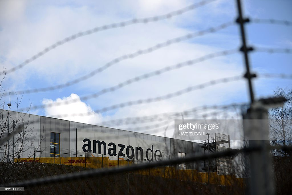 Barbed wire protects the property of the German logistics center of online retailer Amazon in Bad Hersfeld, western Germany on February 20, 2013. The German competition watchdog on Wednesday, February 20, 2013 launched an investigation into the policy of online retailer Amazon which bans third-party traders from selling their products cheaper elswhere on the web. AFP PHOTO / UWE ZUCCHI GERMANY OUT