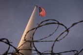 Barbed wire wraps surrounds the base of a flag pole erected by Minutemenstyle activists where US Border Patrol agents are carrying out special...