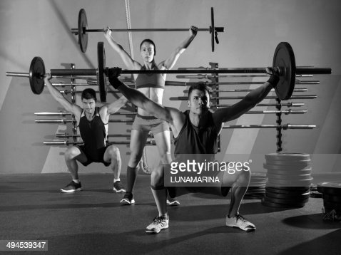 Barbell weight lifting group workout exercise gym : Stock Photo