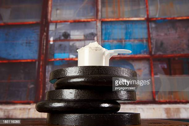 Barbell weights and protein powder