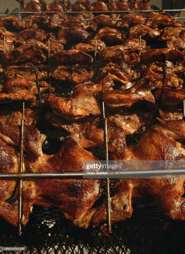 Barbeque chicken, full frame (focus on first row of chicken) : Stock Photo