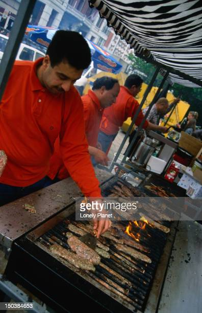 Barbequing meat in a stall in Vondelpark.