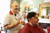 Barber and customer laughing