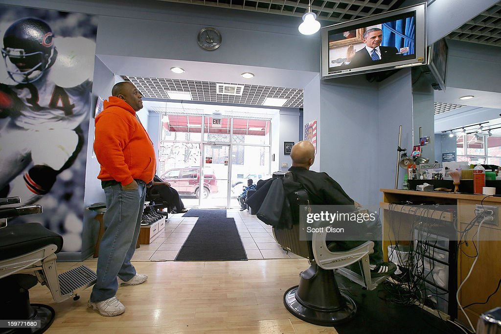 Barber Antonio Coye (R) and Brandon White watch on a television at the Hyde Park Hair Salon as President <a gi-track='captionPersonalityLinkClicked' href=/galleries/search?phrase=Barack+Obama&family=editorial&specificpeople=203260 ng-click='$event.stopPropagation()'>Barack Obama</a> takes the oath of office to officially start his second term on January 20, 2013 in Chicago, Illinois. Obama would get his hair cut at The Hyde Park Hair Salon, which is near his Chicago home, before he was elected to the White House. Chief Justice John Roberts administered the official swearing-in today and a public ceremony will take place January 21.