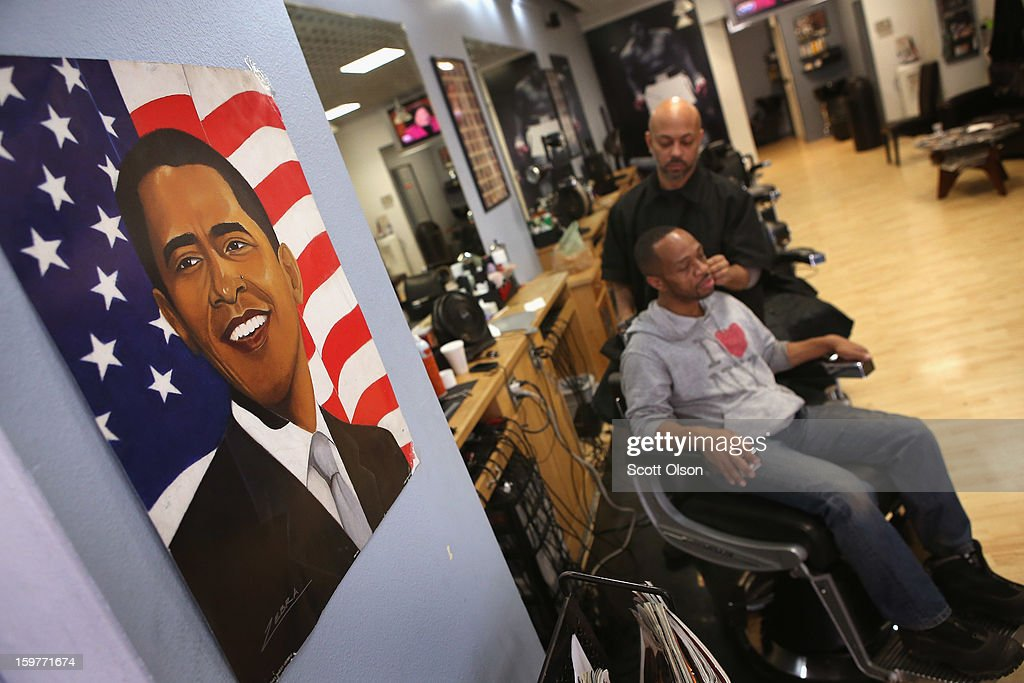 Barber Antonio Coye cuts Stevens Taylor's hair at the Hyde Park Hair Salon moments before U.S. President <a gi-track='captionPersonalityLinkClicked' href=/galleries/search?phrase=Barack+Obama&family=editorial&specificpeople=203260 ng-click='$event.stopPropagation()'>Barack Obama</a> takes the oath of office to officially start his second term on January 20, 2013 in Chicago, Illinois. Obama would get his hair cut at The Hyde Park Hair Salon, which is near his Chicago home, before he was elected to the White House. Chief Justice John Roberts administered the official swearing-in today and a public ceremony will take place January 21.