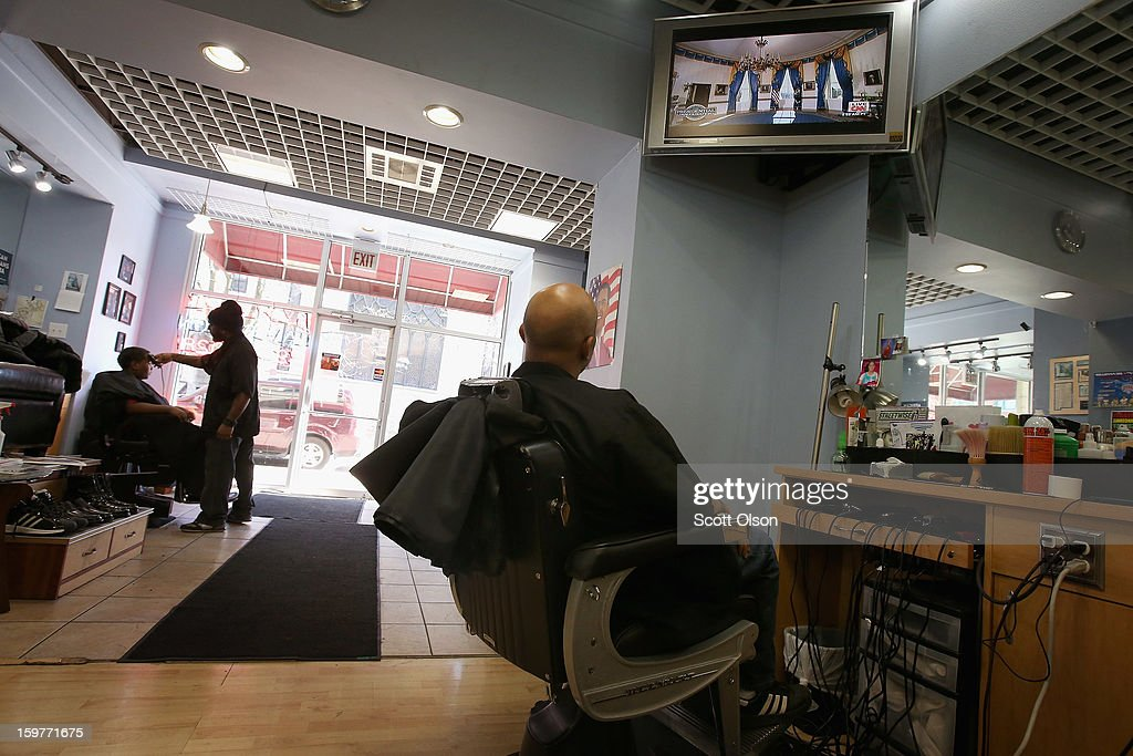 Barber Antonio Coye (R) watches a television from his barber chair at the Hyde Park Hair Salon as U.S. President <a gi-track='captionPersonalityLinkClicked' href=/galleries/search?phrase=Barack+Obama&family=editorial&specificpeople=203260 ng-click='$event.stopPropagation()'>Barack Obama</a> prepares to take the oath of office to officially start his second term on January 20, 2013 in Chicago, Illinois. Obama would get his hair cut at The Hyde Park Hair Salon, which is near his Chicago home, before he was elected to the White House. Chief Justice John Roberts administered the official swearing-in today and a public ceremony will take place January 21.