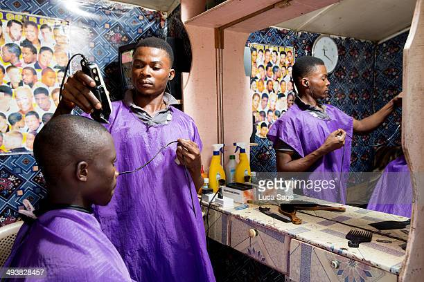 Barber at work in Ghana, Africa
