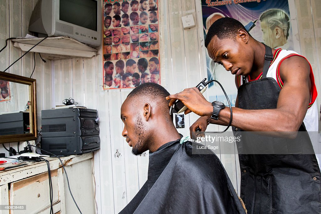 Prestige Barber Shop >> Barber At Work In West Africa Stock Photo | Getty Images