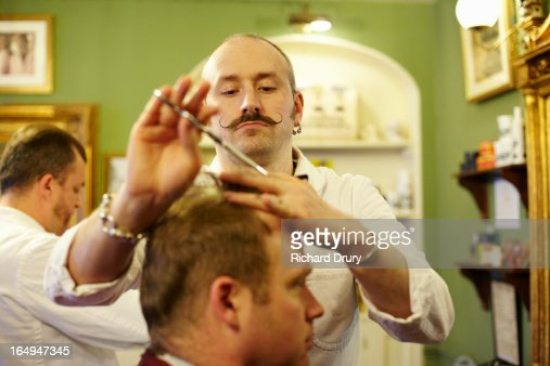 Barber cutting customers hair