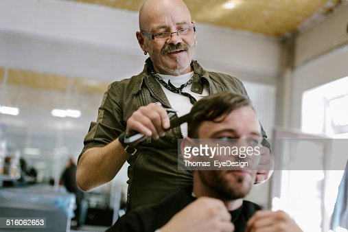 Barber Cutting Customer's Hair