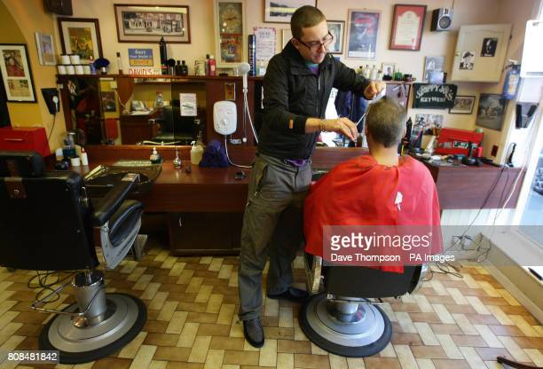 Barber Dan Belcher cuts customer Martin Soloman's hair at Guys Barber's in Knutsford Cheshire in Chancellor George Osborne's constituency