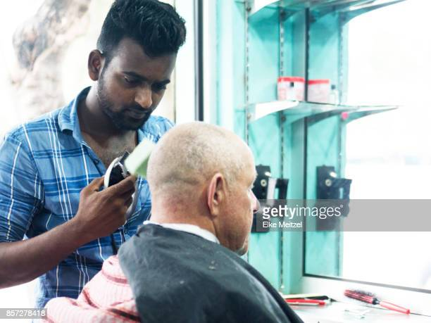 barber examining his work