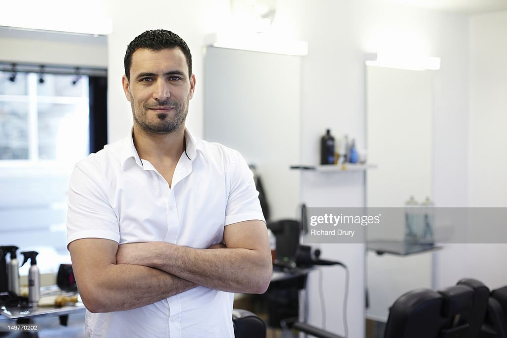 Barber in his shop : Stock Photo