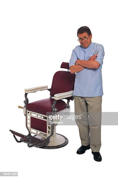 Barber posing by chair