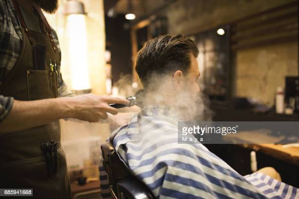 Barber Powdering Man's Neck