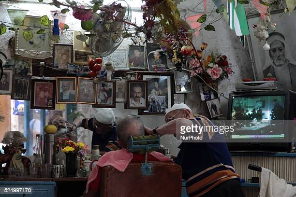 Barber puts pictures of his family on the wall whom have worked in the same saloon oldfashioned Old town of Nablus city wWest Bank on May 31 2015...
