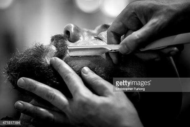 Barber Ricky Trim wet shaves a customer in Manchester's Barber Barber a 'gentleman's saloon' style male barber shop on April 29 2015 in Manchester...