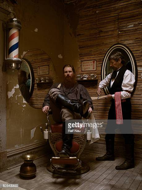 Barber sharpening blade before shaving man's beard