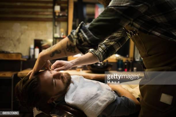 Barber Shaving A Beard
