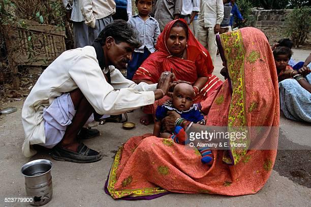Barber Shaving Child's Head in India