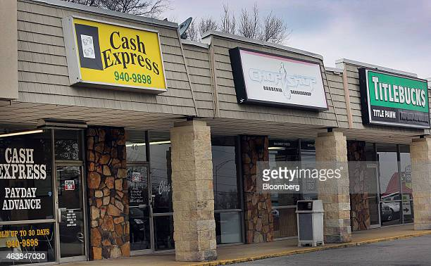 A barber shop stands between two shortterm loan stores in Birmingham Alabama US on Tuesday Feb 10 2015 In Alabama the sixthpoorest state with one of...