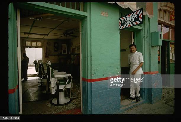 Barber Standing Outside Shop